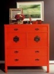 Bright dresser against a gray colored wall