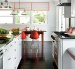 Eames molded plastic chairs in kitchen design
