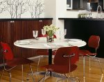 Eames molded plywood chairs in dining area