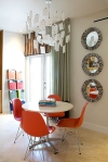 Eames Orange Molded Eiffel chairs in decor space