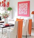 Beautiful design example of utilizing vibrant colors like Orange & Red to add color to a room!