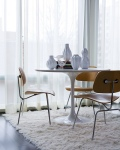 Scandinavian designs Saarinen Tulip Table paired with Eames DCM Chairs