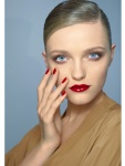 Knock out nails. A quick mani in a sunny shade creates great contrast to the neutral pieces in your wardrobe